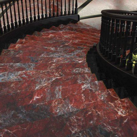 מדרגות שיש מעוקלות בצבע אדום